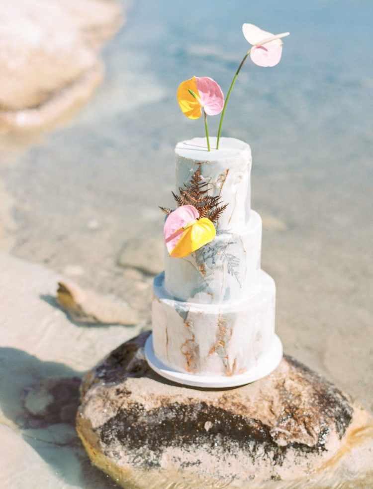 The marbled wedding cake was decorated with bold blooms and gilded leaves