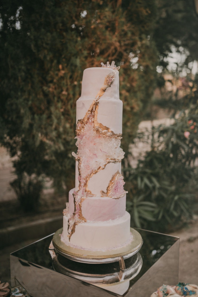 The wedding cake was a pink geode one, with a gold ri and geodes on top