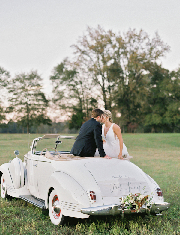 The wedding getaway car was decorated with lush florals and greenery, too