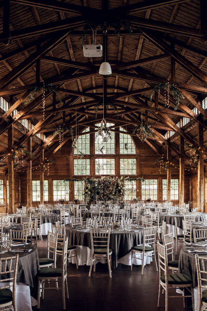 The wedding reception was done with lights, geometric decor and grey linens