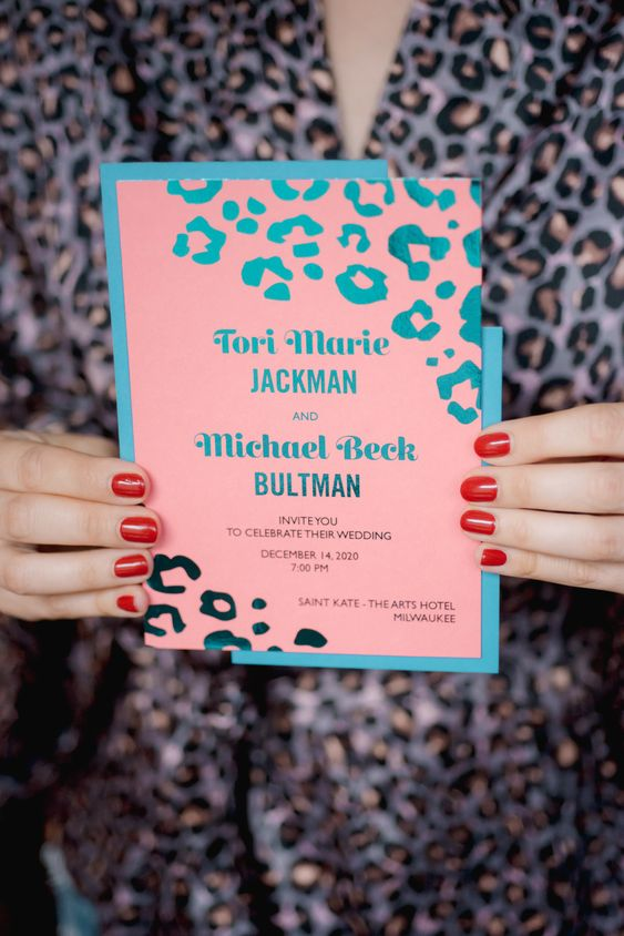 a bright pink, turquoise, teal wedding invitation with a leopard print is a fun and cute idea