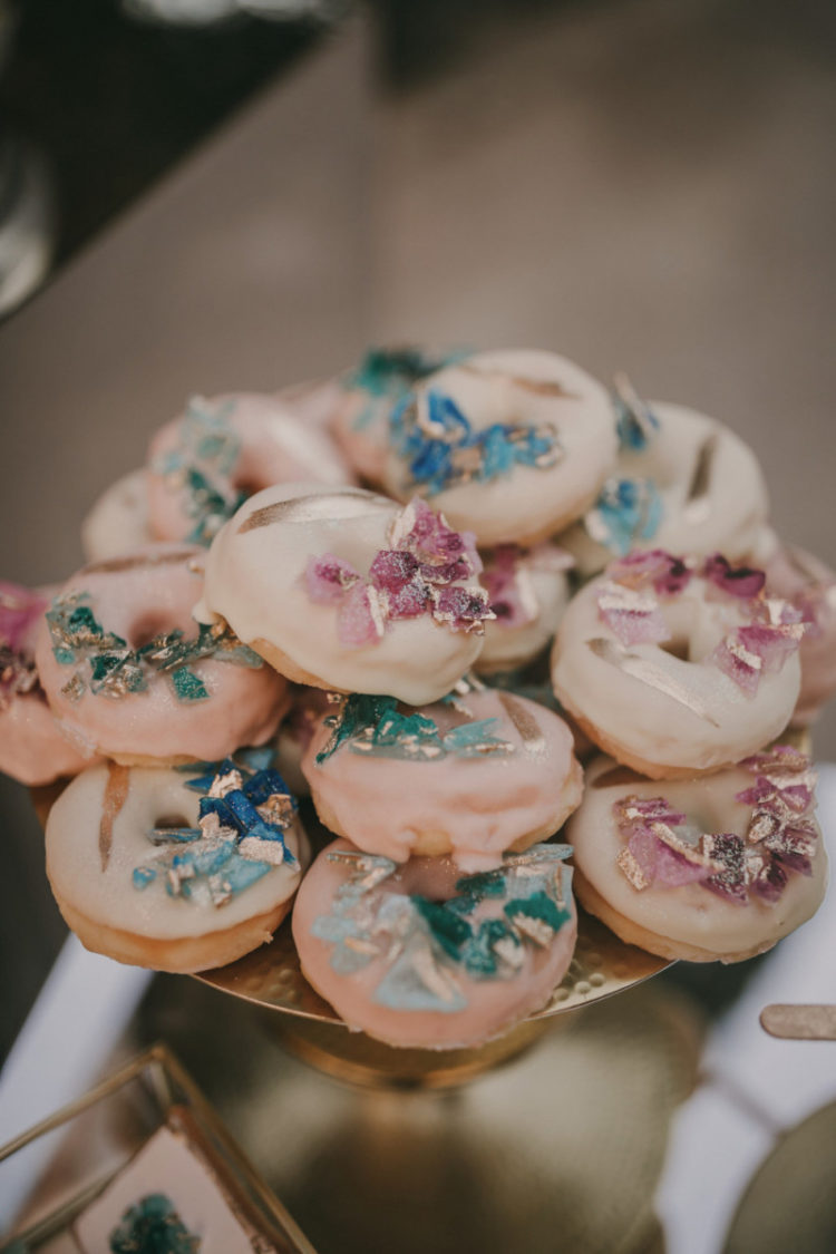 Blush wedding donuts were topped with edible geodes and gold, too