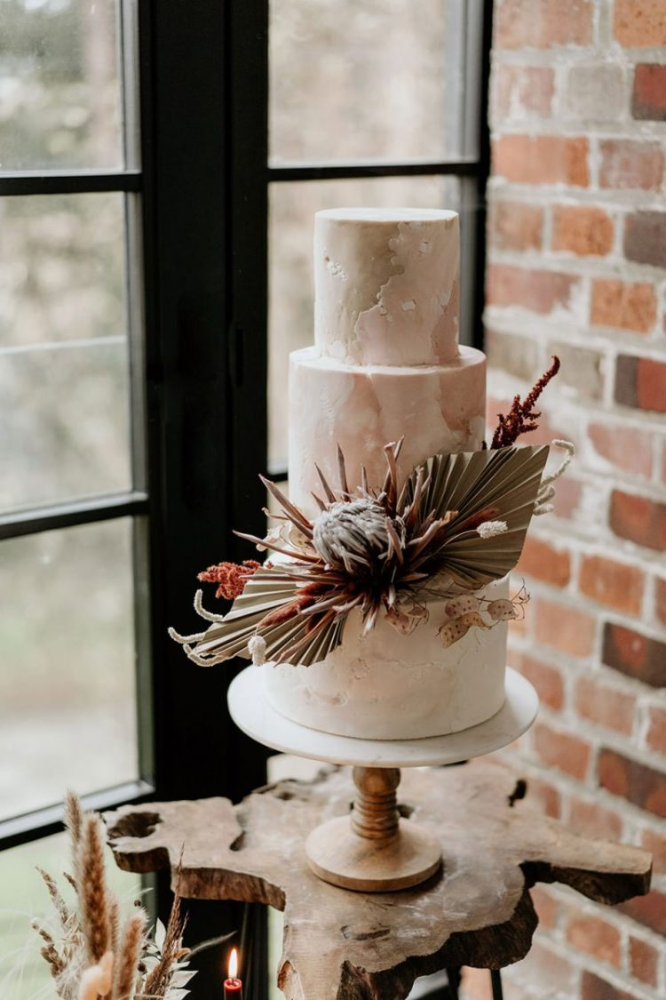 The wedding cake was a pink marble one decorated with large tropical blooms