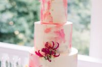 11 The wedding cake was a watercolro pink one with gold leaf and topped with bright blooms