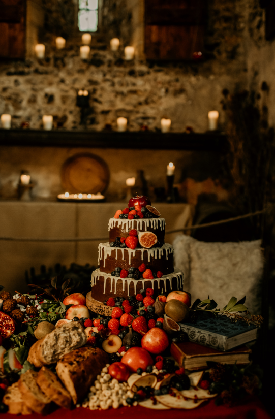 There was a grazing table and a yummy naked wedding cake with drip and fresh fruits and berries