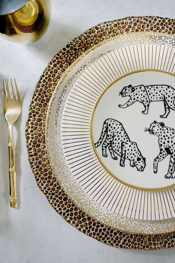 a chic place setting with leopard print and polka dot chargers plus fun elopard print plates