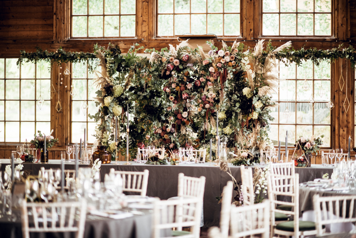 A lush greenery and flower wall was a nice reception backdrop
