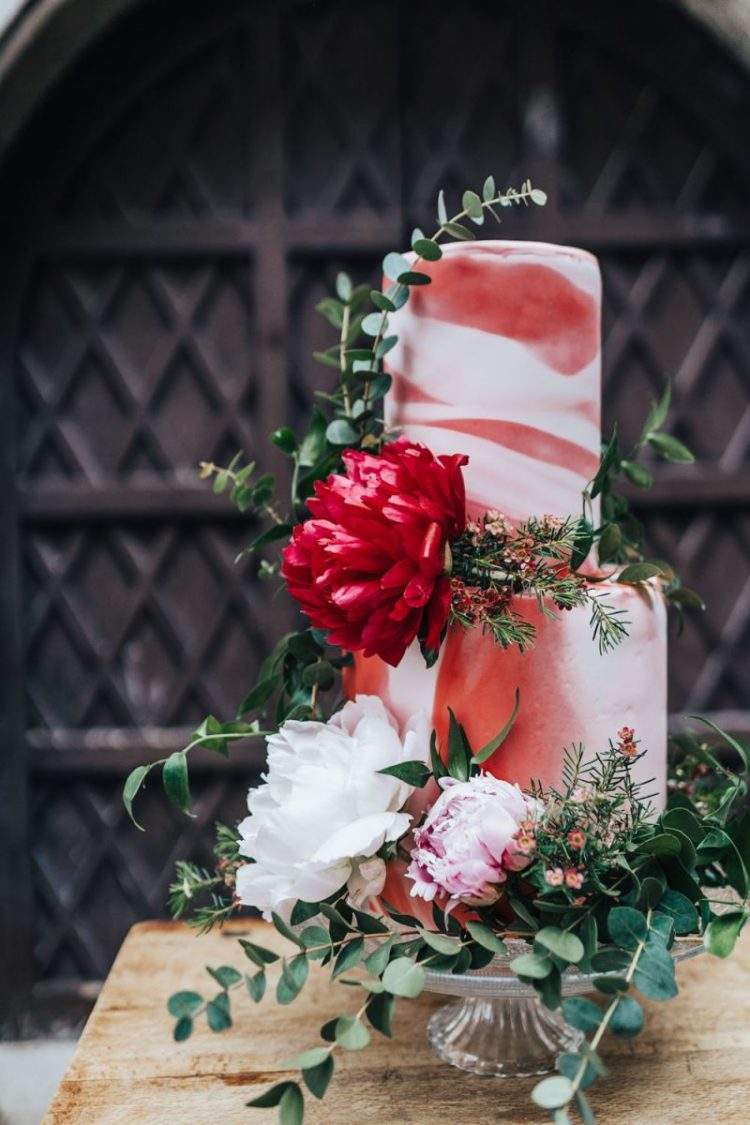 The wedding cake was a watercolor pink and red one, with lush greenery and blooms