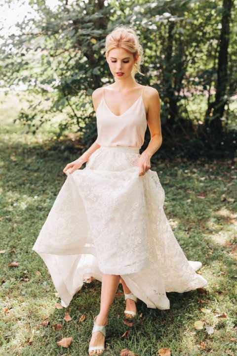 a blush spaghetti strap top and a white lace A-line maxi skirt and neutral heels for a modern or casual bride