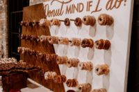 12 a color block donut wall with copper calligraphy and donut holders is a fresh and modern idea to show off your desserts