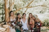 12 mismatching spaghetti strap maxi bridesmaid dresses of silk are bold yet simple and will catch an eye with their colors