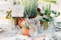 13 a chic wedding centerpiece of greenery and succulents in pots is a cute and sustainable idea for your wedding