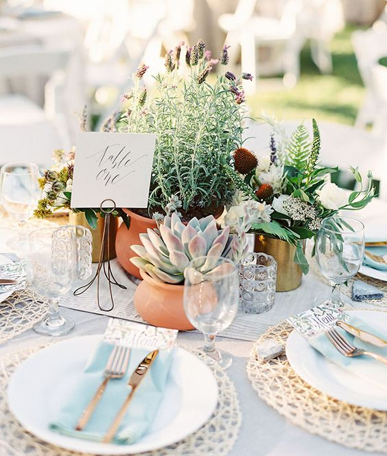 a chic wedding centerpiece of greenery and succulents in pots is a cute and sustainable idea for your wedding