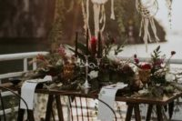 13 a lush wedding tablescape with blooms, greenery, pampas grass, black candles and amber glasses for a boho feel