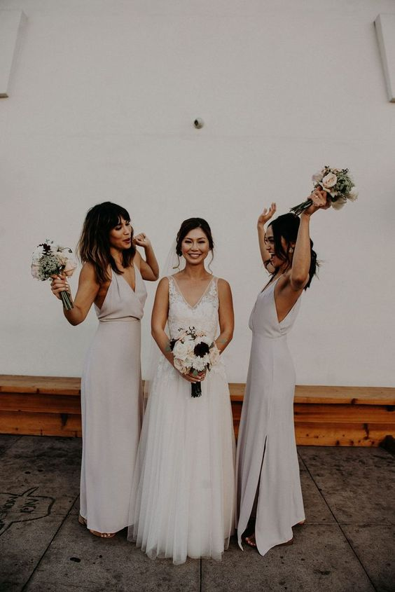 neutral minimalist maxi bridesmaid dresses with deep V-necklines and side slits are trendy