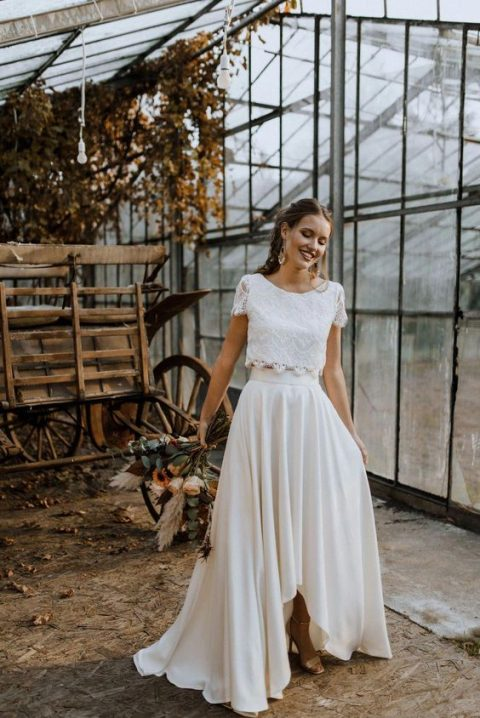 a chic bridal separate with a lace crop top with short sleeves and a pleated high low maxi skirt