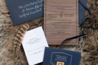 14 a refined wedding invitation suite done with wood grain, navy envelopes and feathers