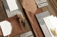 17 an elegant wedding invitation suite done with brown leather and grey watercolor paper