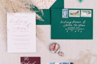 17 colorful wedding stationary in burgundy, blue and emerald, with a leopard print and bold calligraphy