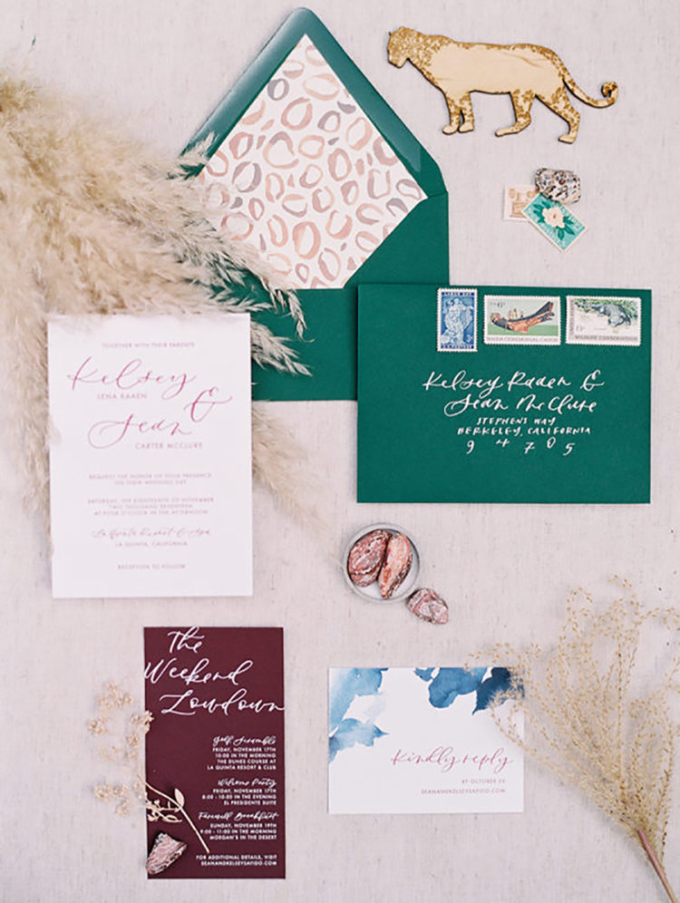 colorful wedding stationary in burgundy, blue and emerald, with a leopard print and bold calligraphy
