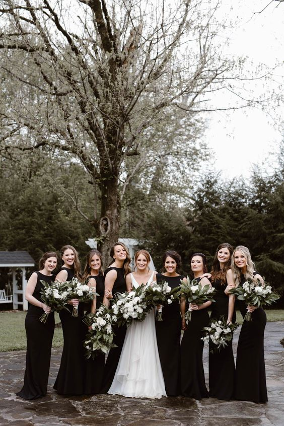 sleeveless black maxi bridesmaid dresses with high necklines are a chic and timeless idea for a wedding