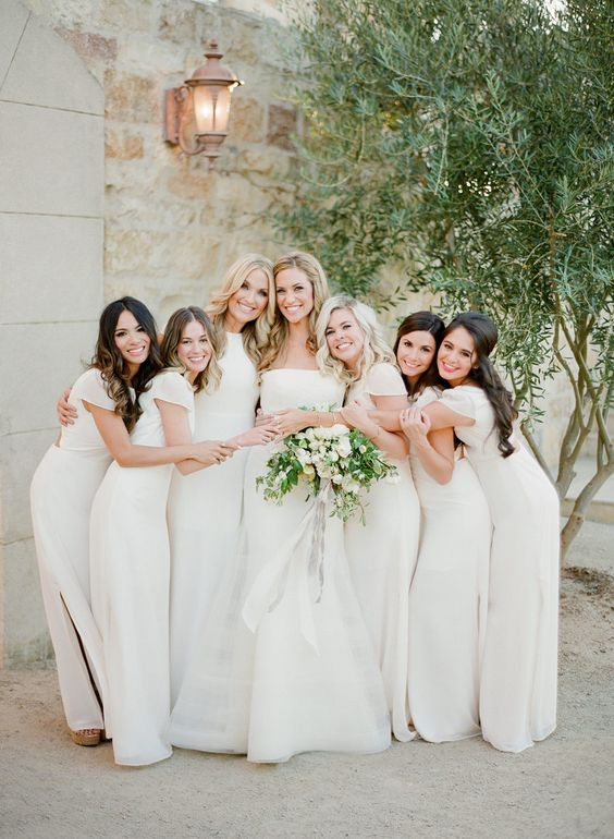 white maxi bridesmaid dresses with cap sleeves and a high neckline plus side slits