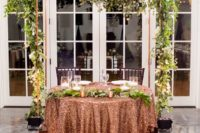 19 a wedding arch placed behind the sweetheart table to highlight it as much as possible