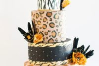 21 a bright and fun leopard and zebra print wedding cake in various colors, with blooms and feathers