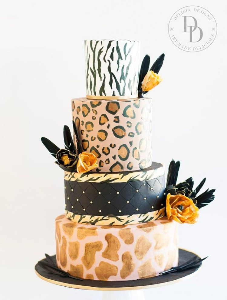 a bright and fun leopard and zebra print wedding cake in various colors, with blooms and feathers