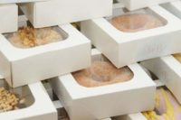 21 glazed donuts in boxes with sheer tops are nice edible favors that will be loved by all the guests
