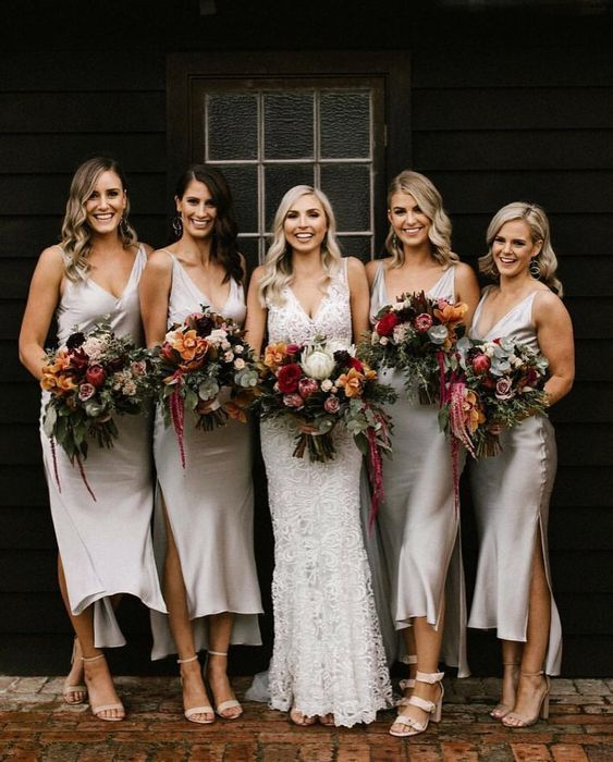 white silk midi high low bridesmaid dresses with V-necklines and side slits look chic