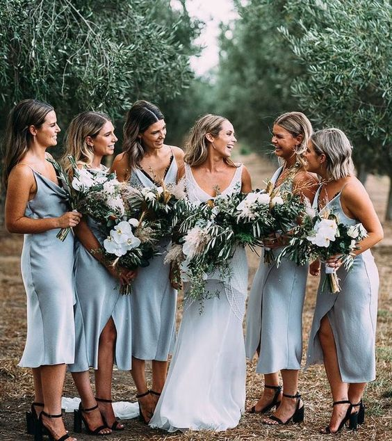 white slip midi bridesmaid dresses with black lace lining and front slits look very chic and sexy