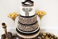 23 a safari-themed wedding cake with leopard tiers and a large elephant one is a bold idea to stand out