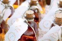 23 your favorite alcohol with tags is a cool idea for a wedding, if it's not with kids