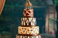 24 a safari-themed wedding cake with various kind sof animal prints and giraffe toppers is a bold idea