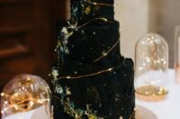 24 a spectacular celestial black wedding cake with watercolors and lights is ideal for a celestial wedding