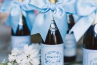 24 mini wine bottles are nice wedding favors that will be loved by most guests