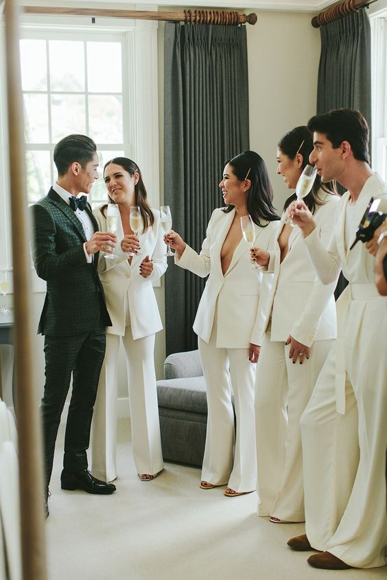 minimalist white pantsuits with no tops under for a sexy and non traditional ridal party look