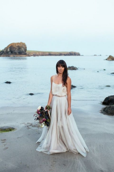 a white silk spaghetti strap top and a layered tulle maxi skirt for a modern coastal bride