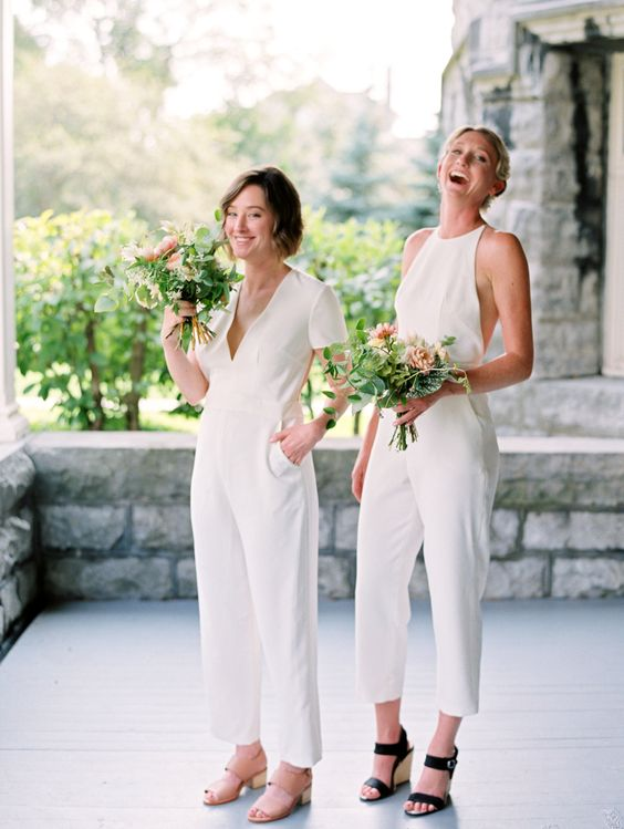 mismatching white bridesmaid jumpsuits with pockets and various shoes