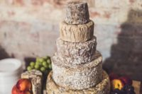 26 a cheese wheel wedding cake is a very cool idea for any wedding, where the couple doesn't like sweets much