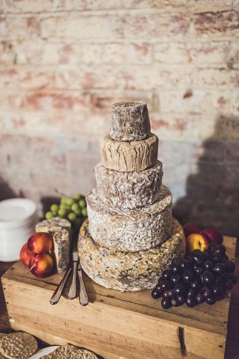 a cheese wheel wedding cake is a very cool idea for any wedding, where the couple doesn't like sweets much