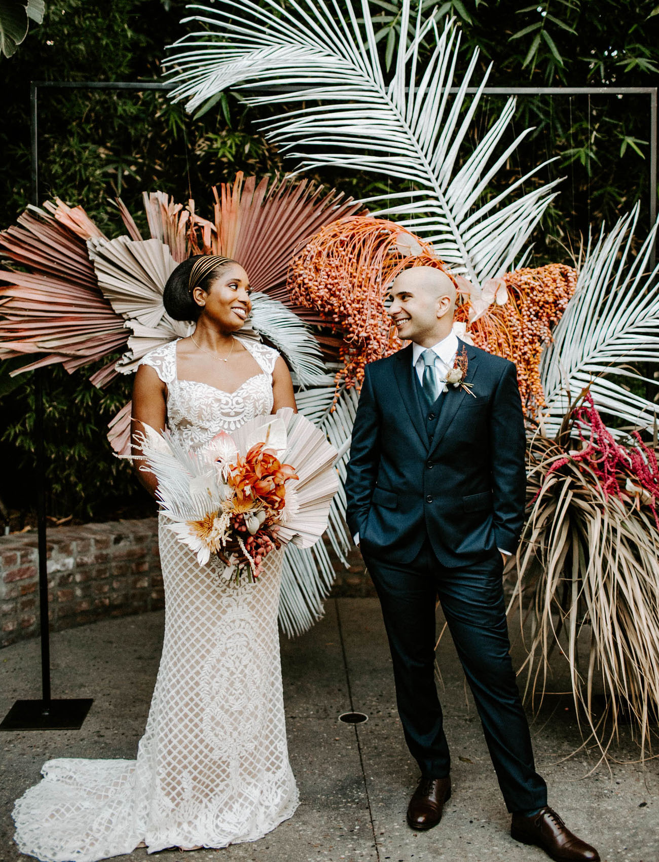 This bold couple went for a tropical refined wedding in downtown LA