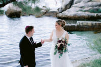 02 The bride was wearing an embellished lace a-line wedding dress with a deep neckline and no sleeves