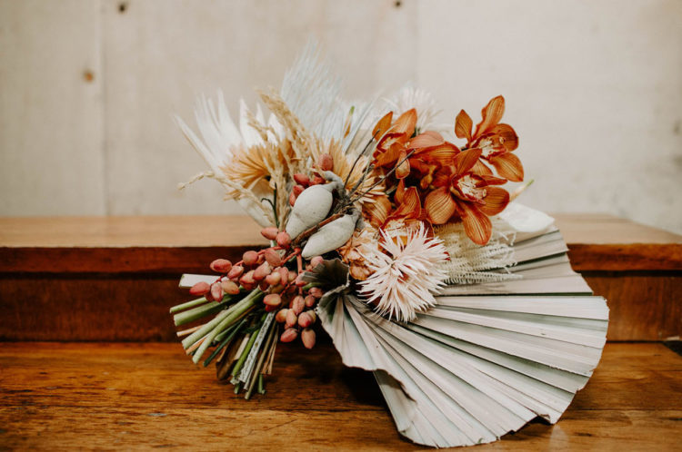 The wedding bouquet was done with bright blooms and lot sof dried elements and leaves