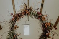 02 The wedding decor was done with dried flowers and herbs and with bright fall blooms