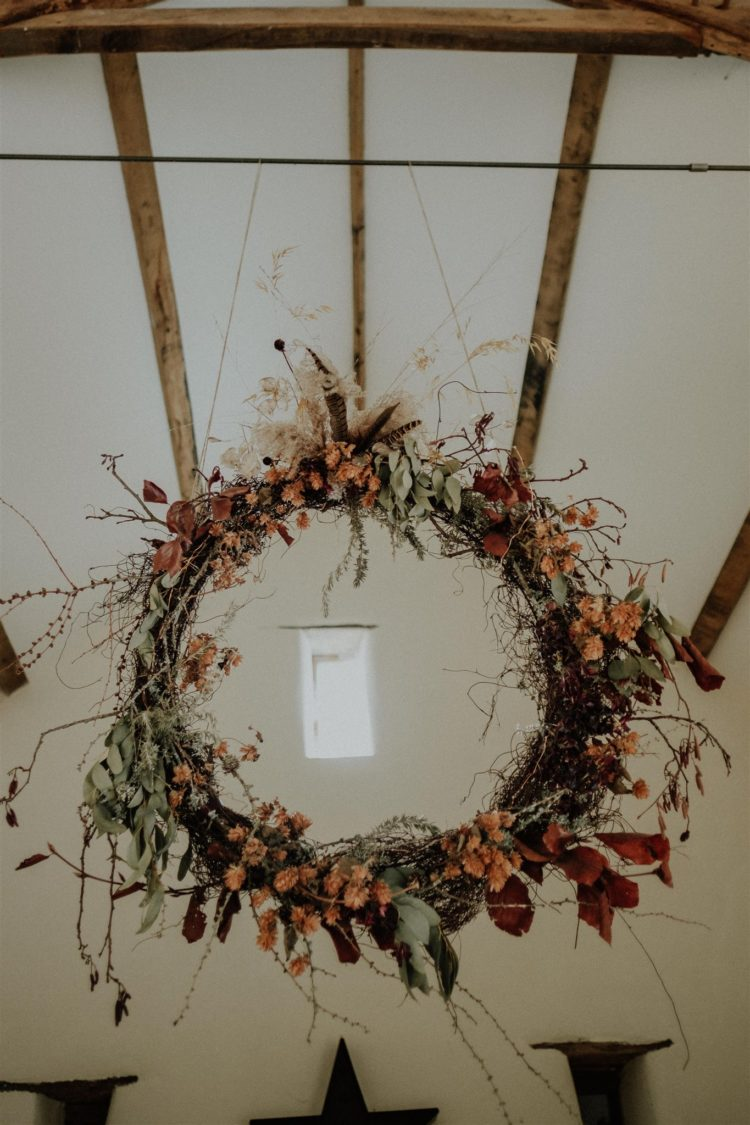 The wedding decor was done with dried flowers and herbs and with bright fall blooms