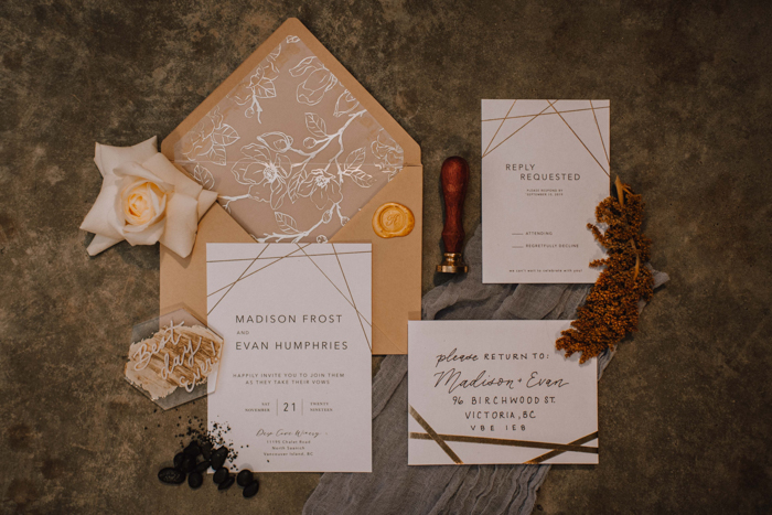The wedding invitation suite was done with geometric and floral patterns, muted colors