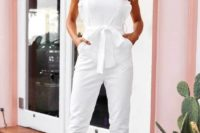 02 a chic and simple white jumpsuit with ruffle straps, a square cut and pockets for a modern and casual bride