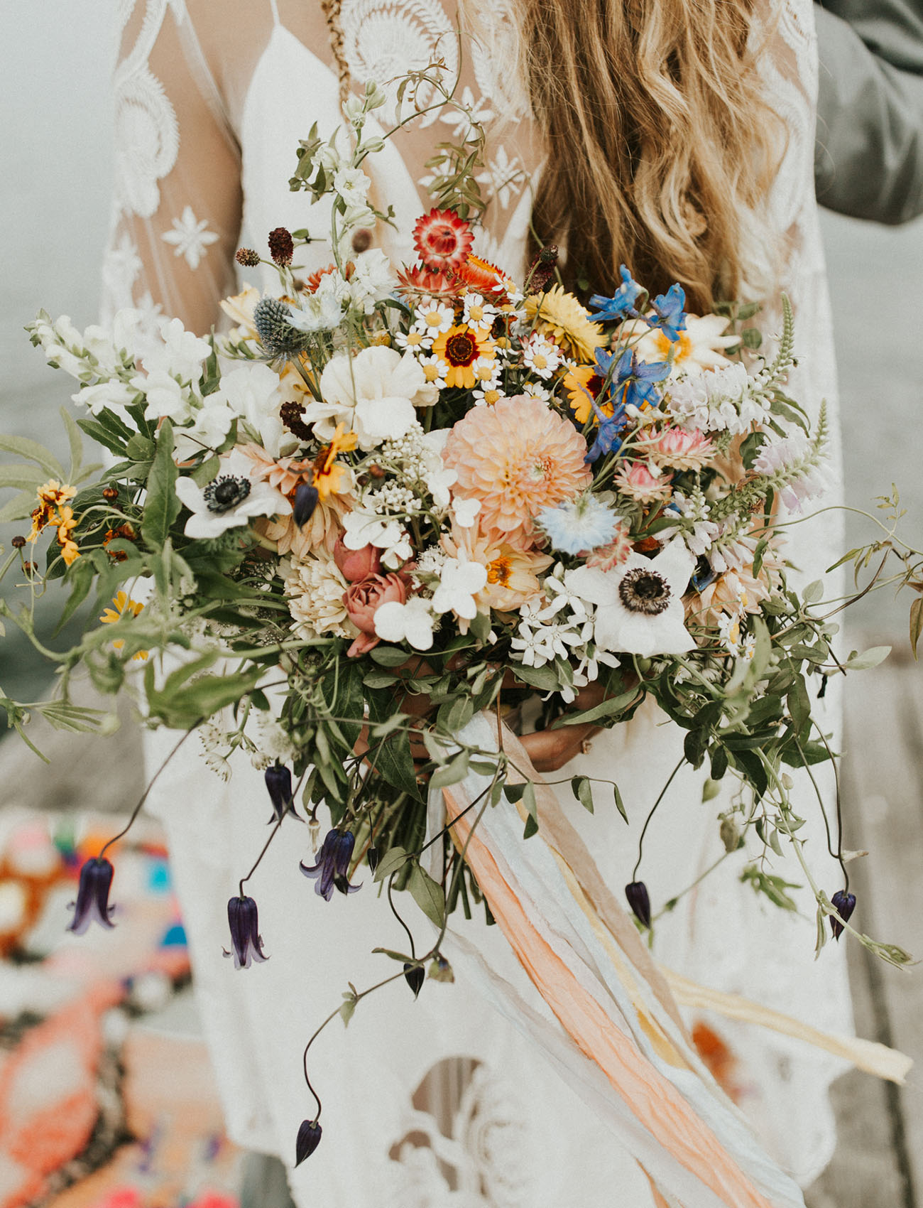 Her bouquet was a wildflower one, with bright and neutral blooms and lots of greenery